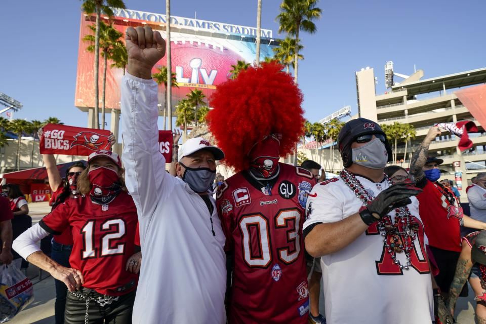 Fans pose before the NFL Super Bowl 55 football game between the Kansas City Chiefs and Tampa Bay Buccaneers, Sunday, Feb. 7, 2021, in Tampa, Fla. (AP Photo/Mark Humphrey)