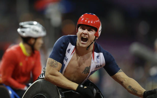 Britain's David Weir celebrates after winning the men's 800m T54 final at the 2012 Paralympics, Thursday, Sept. 6, 2012, in London. (AP Photo/Lefteris Pitarakis)