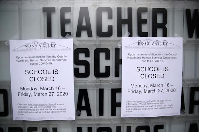 A message board outside of Brookside Elementary school is covered over with signs announcing the school is closed on March 17, 2020, in San Anselmo, Calif. (Justin Sullivan/Getty Images)