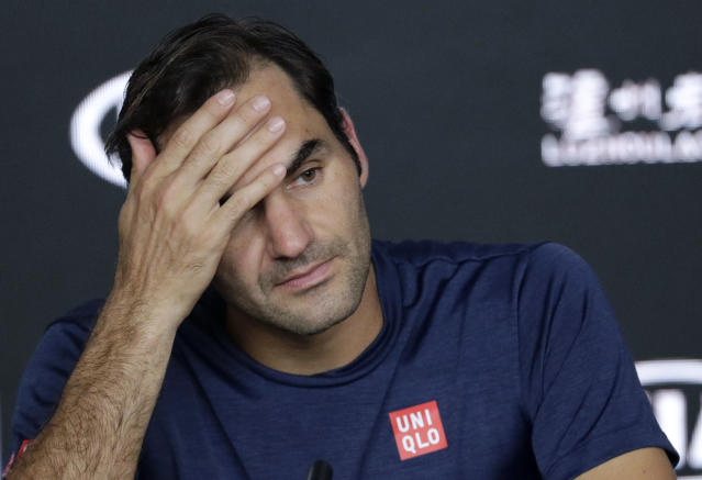 <p> Switzerland's Roger Federer answers questions at a press conference following his fourth round loss to Greece's Stefanos Tsitsipas at the Australian Open tennis championships in Melbourne, Australia, Sunday, Jan. 20, 2019. (AP Photo/Aaron Favila) </p>