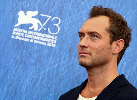 """FILE PHOTO - Actor Jude Law attends the photocall for the movie """"The Young Pope"""" at the 73rd Venice Film Festival in Venice, Italy September 3, 2016.  REUTERS/Alessandro Bianchi/File Photo"""
