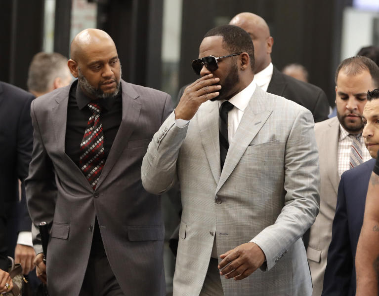 R Kelly pleads not guilty to 11 sex assault charges