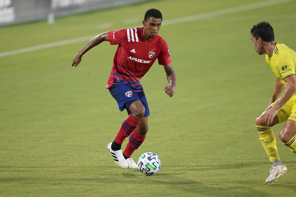 FC Dallas defender Reggie Cannon was the subject of death threats after teams took a knee during the national anthem with fans in attendance. (George Walker/Icon Sportswire via Getty Images)