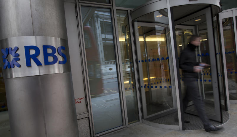 A pedestrian walks past the logo of the Royal Bank Of Scotland (RBS), as the bank announced its results for 2012 in London, Thursday, Feb. 28, 2013. Part-nationalized RBS said Thursday it ended 2012 with massive losses after it set aside more cash to compensate customers who were mis-sold financial products and to pay fines related to a rate-rigging scandal. The bank, which is 82 percent owned by British taxpayers, said its fourth quarter losses increased 44 percent from a year earlier, to 2.60 billion pounds. That led to a full-year loss of 5.97 billion pounds ($9 billion), up from a shortfall of 2 billion pounds in 2011.(AP Photo/Alastair Grant)