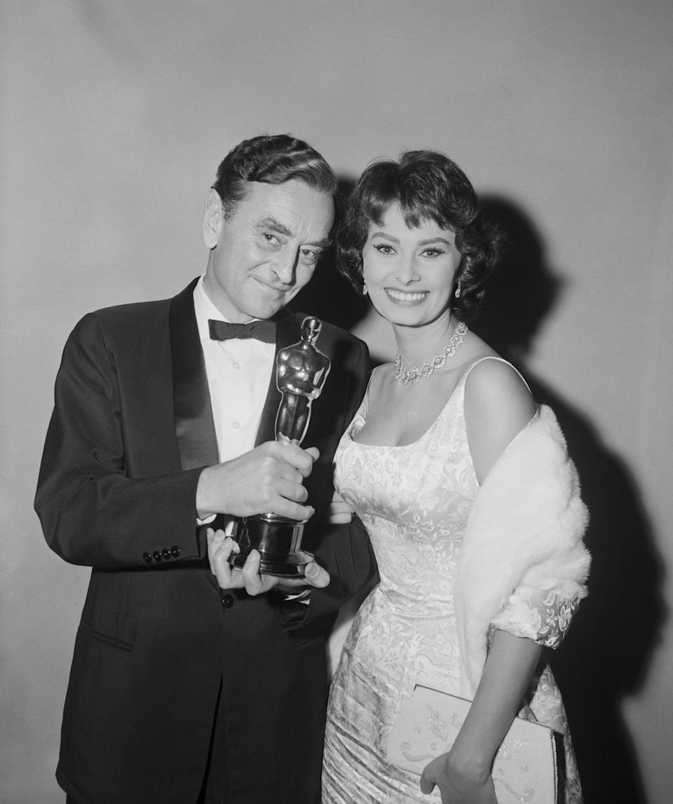 <p>Sophia wore a skintight satin floral dress to the Oscars in 1958. </p>