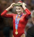 <p>Carly Patterson of the United States adjusts her olive branch crown on the podium as she receives her gold medal as the women's all-around gymnastics champion at the 2004 Summer Olympic Games in Athens, Greece. (Photo by Barry Chin/The Boston Globe via Getty Images) </p>