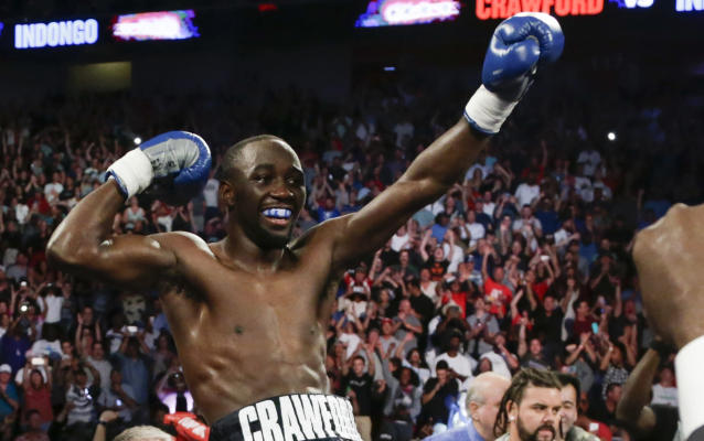 FILE - In this Aug. 19, 2017, file photo, Terence Crawford celebrates his victory by knockout over Julius Indongo in the third round of a junior welterweight world title unification bout in Lincoln, Neb. Jeff Horn and Terence Crawford, both unbeaten, meet Saturday night, June 9, 2018, in Las Vegas for Horn's welterweight title in a fight that offers an intriguing matchup of brawler versus boxer in a division that is suddenly getting a lot of attention in boxing. (AP Photo/Nati Harnik, File)