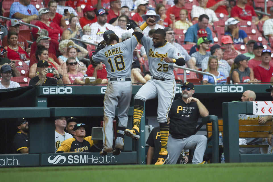 Pittsburgh Pirates' Ben Gamel, left, is congratulated by teammate Gregory Polanco after hitting a home run during the fifth inning of a baseball game against the St. Louis Cardinals, Sunday, June 27, 2021, in St. Louis. (AP Photo/Joe Puetz)