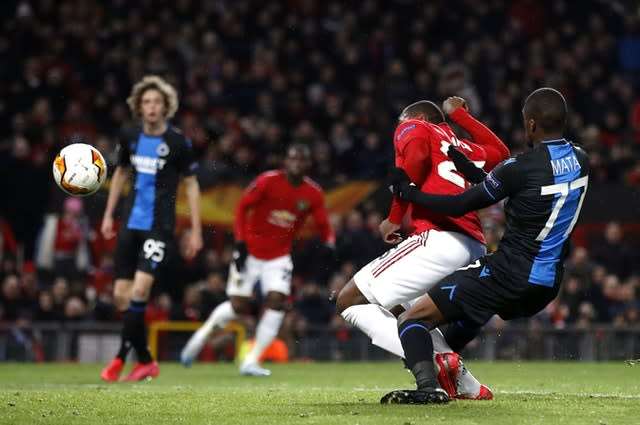 Odion Ighalo steers home his first United goal (Maritn Rickett/PA)