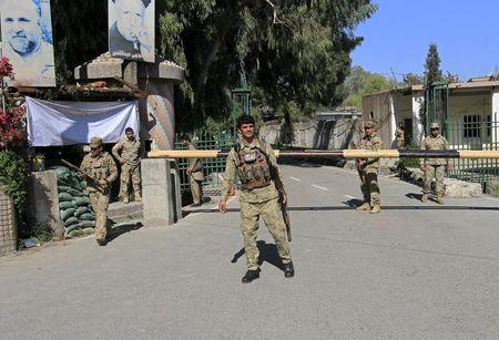 Afghan civil order policemen stand guard at the gate of a provincial governor's office in Jalalabad April 8, 2015. REUTERS/Parwiz