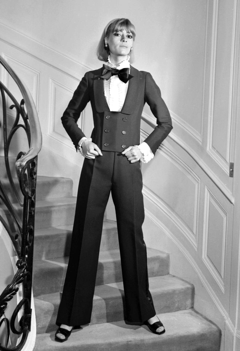 A model in an alpaca spencer dinner jacket, jabot blouse, and black silk bow tie for the Yves Saint Laurent 1967 Spring-Summer haute couture collection. (Photo: AFP/Getty Images)