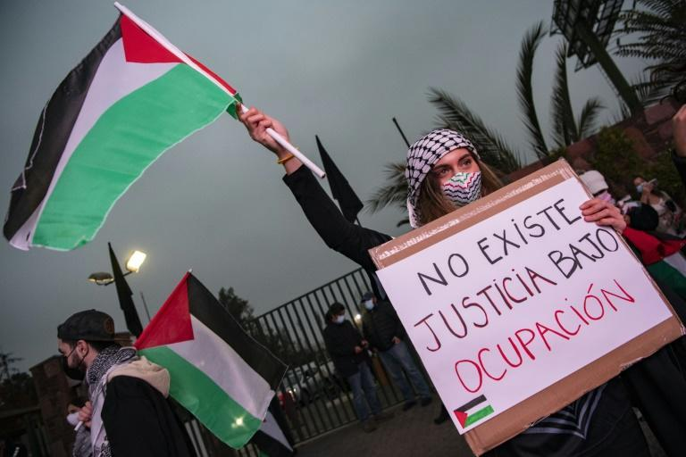 Members of the Palestinian community in Chile take part in a protest against Israel's military operations in Gaza and in support of the Palestinian people, in Santiago on May 18, 2021