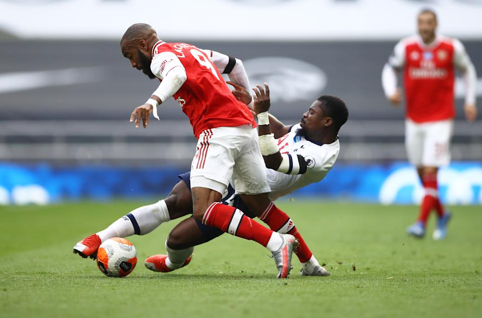 Tottenham Hotspur's Serge Aurier (right) in action with Arsenal's Alexandre Lacazette.