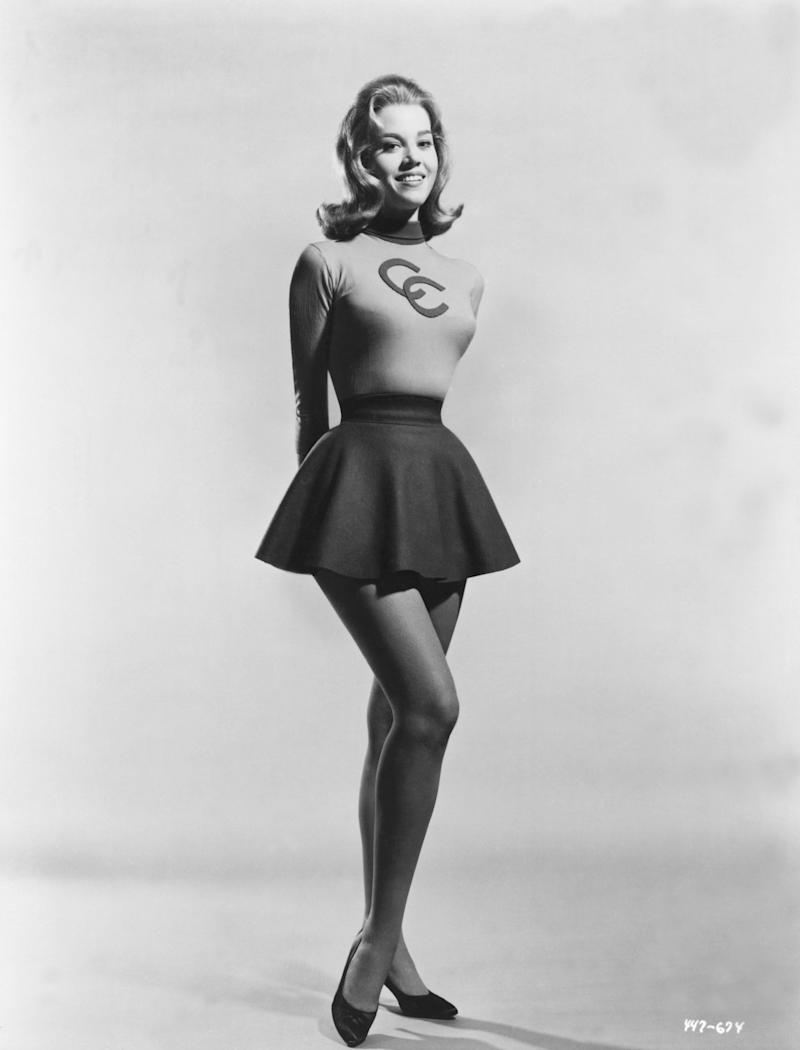 Fonda in a cheerleader outfit.