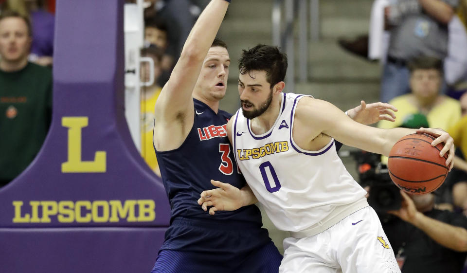 Lipscomb forward Rob Marberry (0) drives against Liberty forward Scottie James (31) in the first half of the Atlantic Sun NCAA college basketball tournament championship game Sunday, March 10, 2019, in Nashville, Tenn. (AP Photo/Mark Humphrey)