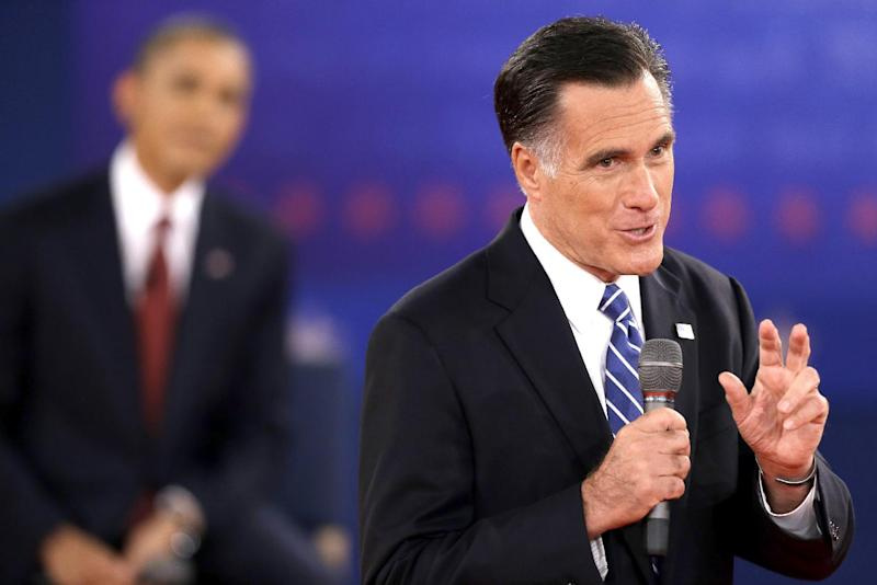 FILE - In this Oct. 16, 2012, file photo, Republican presidential candidate, former Massachusetts Gov. Mitt Romney speaks while President Barack Obama listens during the second presidential debate at Hofstra University in Hempstead, N.Y. When it comes to debates, Mitt Romney loves the rules. The eyes of millions of voters upon him, the Republican candidate is quick to poke holes in his rival's arguments. But he's just as ready to take the moderator to task when he believes the predetermined ground rules have been breached. (AP Photo/David Goldman, File)