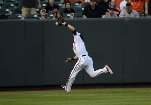 Baltimore Orioles left fielder Nate McLouth (9) can't handle a fly ball hit by New York Yankees' Brett Gardner for a double in the first inning of a baseball game, Tuesday, May 21, 2013, in Baltimore. (AP Photo/Nick Wass)