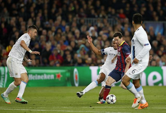 Barcelona's Lionel Messi, 3rd left tries to get through the Manchester City defence during a Champions League, round of 16, second leg, soccer match between FC Barcelona and Manchester City at the Camp Nou Stadium in Barcelona, Spain, Wednesday March 12, 2014. (AP Photo/Emilio Morenatti)
