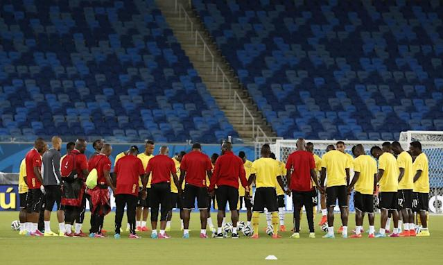 Ghana players gather on the pitch during an official training session the day before the group G World Cup soccer match between Ghana and the United States at the Arena das Dunas in Natal, Brazil, Sunday, June 15, 2014. (AP Photo/Dolores Ochoa)