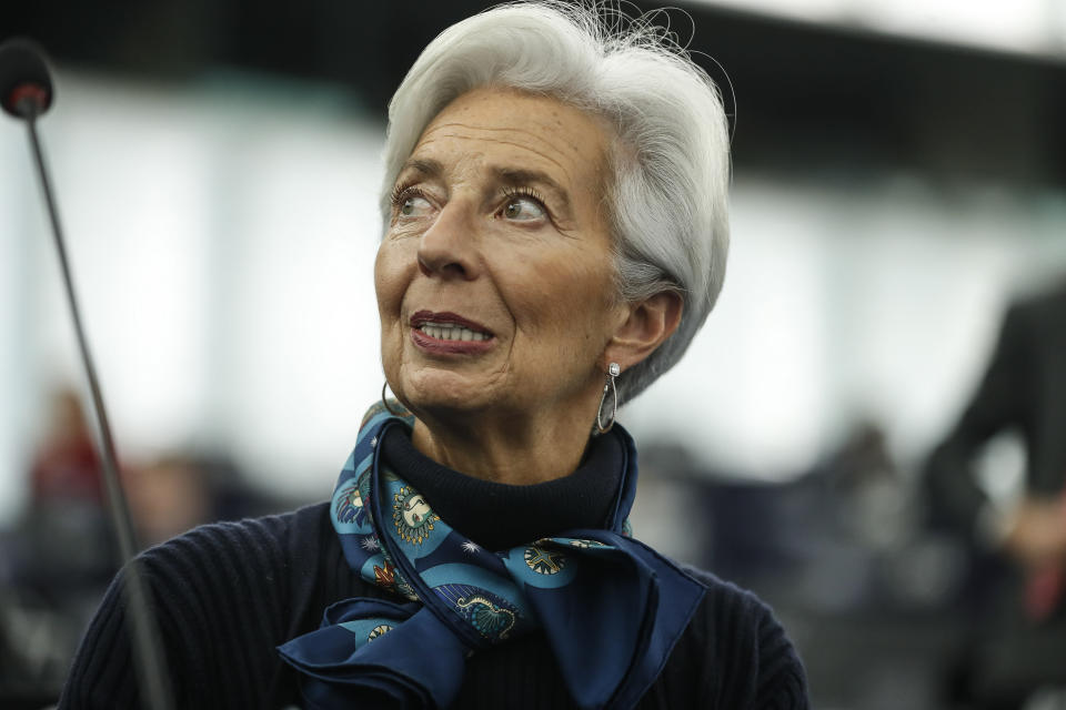 FILE - In this Tuesday Feb. 11, 2020 file photo, Christine Lagarde president of the ECB looks up prior to deliver her speech before the European Parliament's economic and monetary affairs committee at the European Parliament in Strasbourg, France. Lagarde says on Wednesday, Nov. 11, the recovery could be bumpy until vaccination becomes widespread. That warning came in a speech at an online ECB conference. While recent news of vaccine tests is promising, Lagarde says the economy could face recurring cycles of growth and restrictions until enough people can be vaccinated. (AP Photo/Jean-François Badias, File)