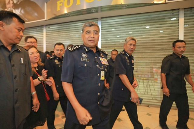 Khalid (centre) claimed the allegation was aimed at tarnishing the image of the Royal Malaysian Police. — Picture by Saw Siow Feng