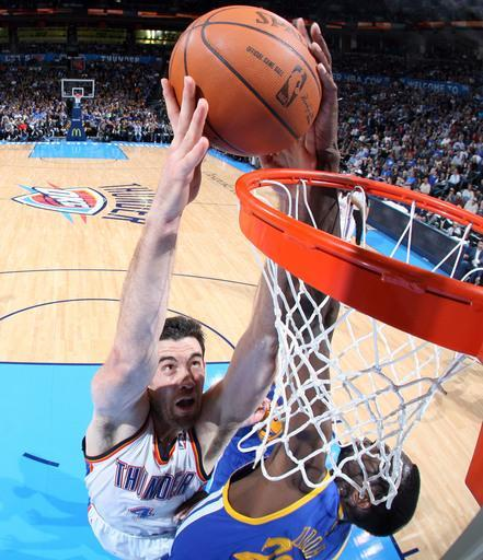 OKLAHOMA CITY, OK - FEBRUARY 17: Nick Collison #4 of the Oklahoma City Thunder goes to the basket against Ekpe Udoh #20 of the Golden State Warriors during the game on February 17, 2012 at the Chesapeake Energy Arena in Oklahoma City, Oklahoma. (Photo by Layne Murdoch/NBAE via Getty Images)