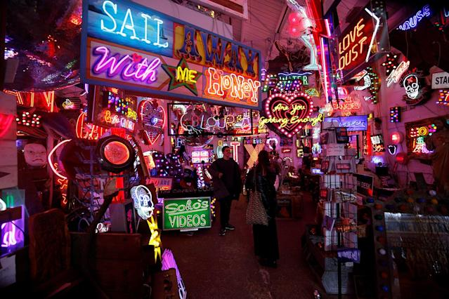 <p>People pose as they take pictures of each other in front of neon lights and artworks in God's Own Junkyard gallery and cafe in London, Britain, March 31, 2017. (Photo: Russell Boyce/Reuters) </p>