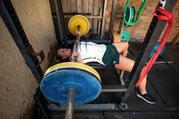 Australian rower Georgie Rowe trains in isolation in a backyard gym in Sydney.