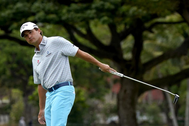 Kevin Kisner reacts to his putt on the 16th green during the third round of the Sony Open PGA Tour golf event, Saturday, Jan. 11, 2020, at Waialae Country Club in Honolulu. (AP Photo/Matt York)
