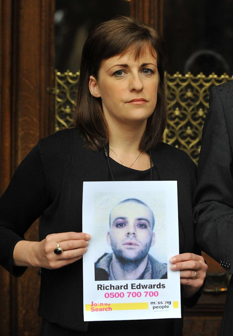 Rachel Elias, sister of missing Manic Street Preachers guitarist Richey Edwards, holds up posters of her missing loved one outside the Houses of Parliament, London, ahead of her giving evidence at the UK's first Parliamentary Inquiry into the rights of families of missing people. (Photo by Clive Gee/PA Images via Getty Images)