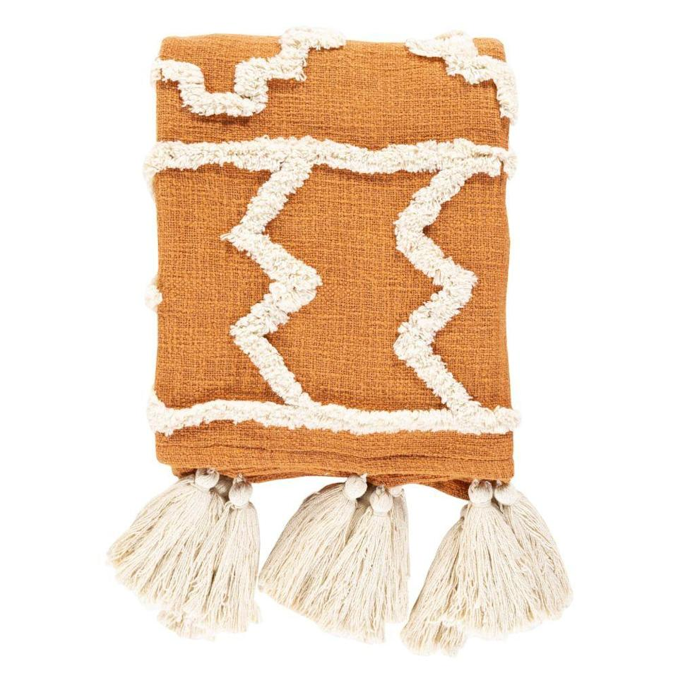 """<p><strong>Jungalow</strong></p><p>jungalow.com</p><p><strong>$119.00</strong></p><p><a href=""""https://www.jungalow.com/products/tangerine-throw-blanket?_pos=1&_sid=f0a2a5210&_ss=r"""" rel=""""nofollow noopener"""" target=""""_blank"""" data-ylk=""""slk:Shop Now"""" class=""""link rapid-noclick-resp"""">Shop Now</a></p><p>Interior Designer Justina Blakeney's joyful interiors—filled with wares from her boho-chic Jungalow line—will make you smile. This stitched-and-tasseled throw will bring a little sunshine to any couch setup. </p>"""