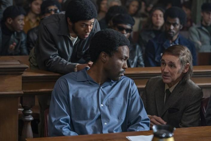"THE TRIAL OF THE CHICAGO 7 (L to R) KELVIN HARRISON JR. as Fred Hampton, YAHYA ABDUL-MATEEN II as Bobby Seale, MARK RYLANCE as William Kuntsler in ""THE TRIAL OF THE CHICAGO 7."" Credit: NIKO TAVERNISE/NETFLIX"