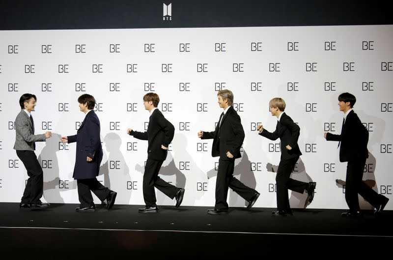 """FILE PHOTO: Members of K-pop boy band BTS pose for photographs during a news conference promoting their new album """"BE(Deluxe Edition)"""" in Seoul"""