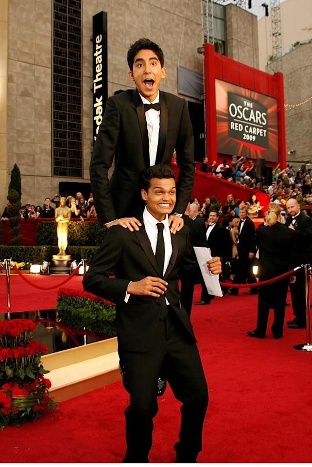 Actors Madhur Mittal (bottom) and Dev Patel (top) arrives at the 81st Annual Academy Awards -- Feb. 22, 2009