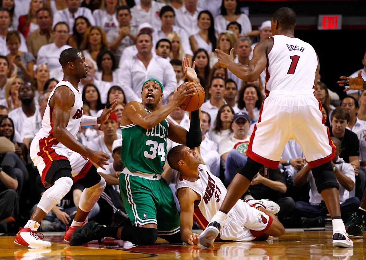 MIAMI, FL - JUNE 09:  Paul Pierce #34 of the Boston Celtics looks to pass the ball as he is on his knees defended by Dwyane Wade #3 and Shane Battier #31 of the Miami Heat in the first half in Game Seven of the Eastern Conference Finals in the 2012 NBA Playoffs on June 9, 2012 at American Airlines Arena in Miami, Florida. NOTE TO USER: User expressly acknowledges and agrees that, by downloading and or using this photograph, User is consenting to the terms and conditions of the Getty Images License Agreement.  (Photo by Mike Ehrmann/Getty Images)