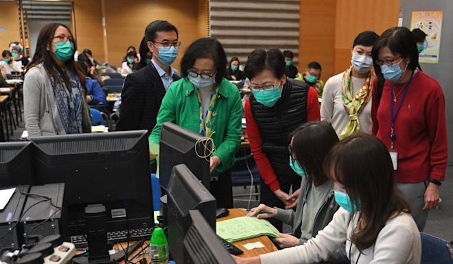 Secretary for Food and Health Sophia Chan Siu-chee (in green) and Chief Executive Carrie Lam Cheng Yuet-ngor visit a coronavirus hotline centre on March 8. Photo: Facebook