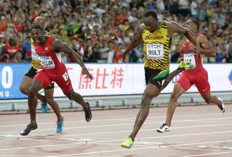 Jamaica's Usain Bolt, right, wins the gold medal in the men's 100m ahead of United States' Justin Gatlin, left, at the World Athletics Championships at the Bird's Nest stadium in Beijing, Sunday, Aug. 23, 2015. (AP Photo/Lee Jin-man)