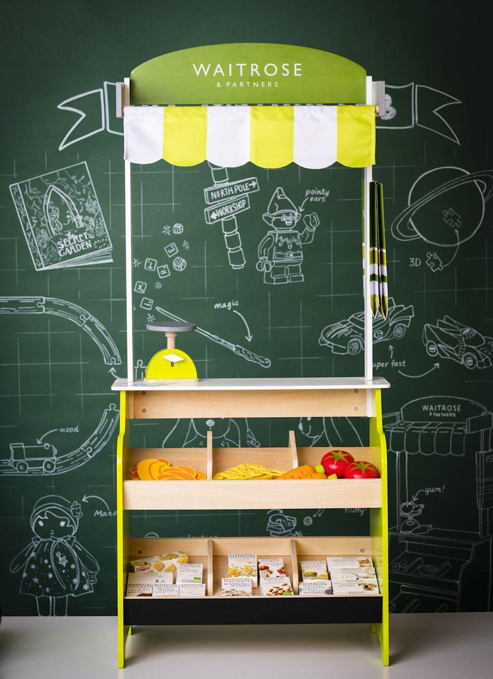 """<p>This mini Waitrose supermarket is so sweet! Featuring shelves for toy food, a Waitrose logo and scales for weighing produce, we're certain it will provide hours of fun. Complete the look with the mini <a href=""""https://go.redirectingat.com?id=127X1599956&url=https%3A%2F%2Fwww.johnlewis.com%2Fjohn-lewis-partners-waitrose-shopping-trolley%2Fp4351590&sref=https%3A%2F%2Fwww.housebeautiful.com%2Fuk%2Flifestyle%2Fshopping%2Fg33979702%2Fjohn-lewis-christmas-toys%2F"""" rel=""""nofollow noopener"""" target=""""_blank"""" data-ylk=""""slk:Waitrose trolley"""" class=""""link rapid-noclick-resp"""">Waitrose trolley</a>. </p><p><a class=""""link rapid-noclick-resp"""" href=""""https://go.redirectingat.com?id=127X1599956&url=https%3A%2F%2Fwww.johnlewis.com%2Fbaby-child%2Fshop-toys%2Fc19051712&sref=https%3A%2F%2Fwww.housebeautiful.com%2Fuk%2Flifestyle%2Fshopping%2Fg33979702%2Fjohn-lewis-christmas-toys%2F"""" rel=""""nofollow noopener"""" target=""""_blank"""" data-ylk=""""slk:SHOP TOYS AT JOHN LEWIS"""">SHOP TOYS AT JOHN LEWIS</a></p>"""