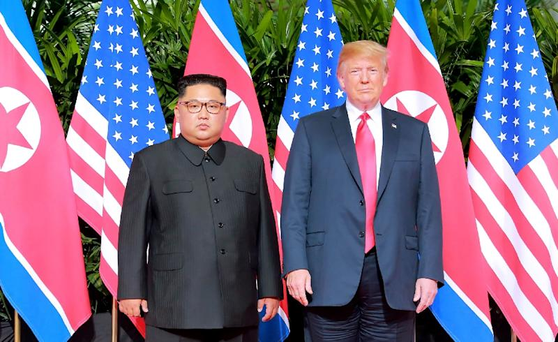 US President Donald Trump (R) meets with North Korea's leader Kim Jong Un (L) at the start of their historic US-North Korea summit, where agreement on returning US remains was reached (AFP Photo/-)