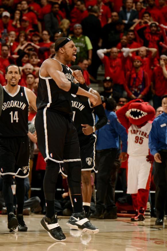 TORONTO, ON - MAY 4: Paul Pierce #34 of the Brooklyn Nets celebrates after winning against the Toronto Raptors in Game Seven of the Eastern Conference Quarterfinals during the NBA Playoffs at the Air Canada Centre on May 4, 2014 in Toronto, Ontario, Canada. (Photo by Ron Turenne/NBAE via Getty Images)