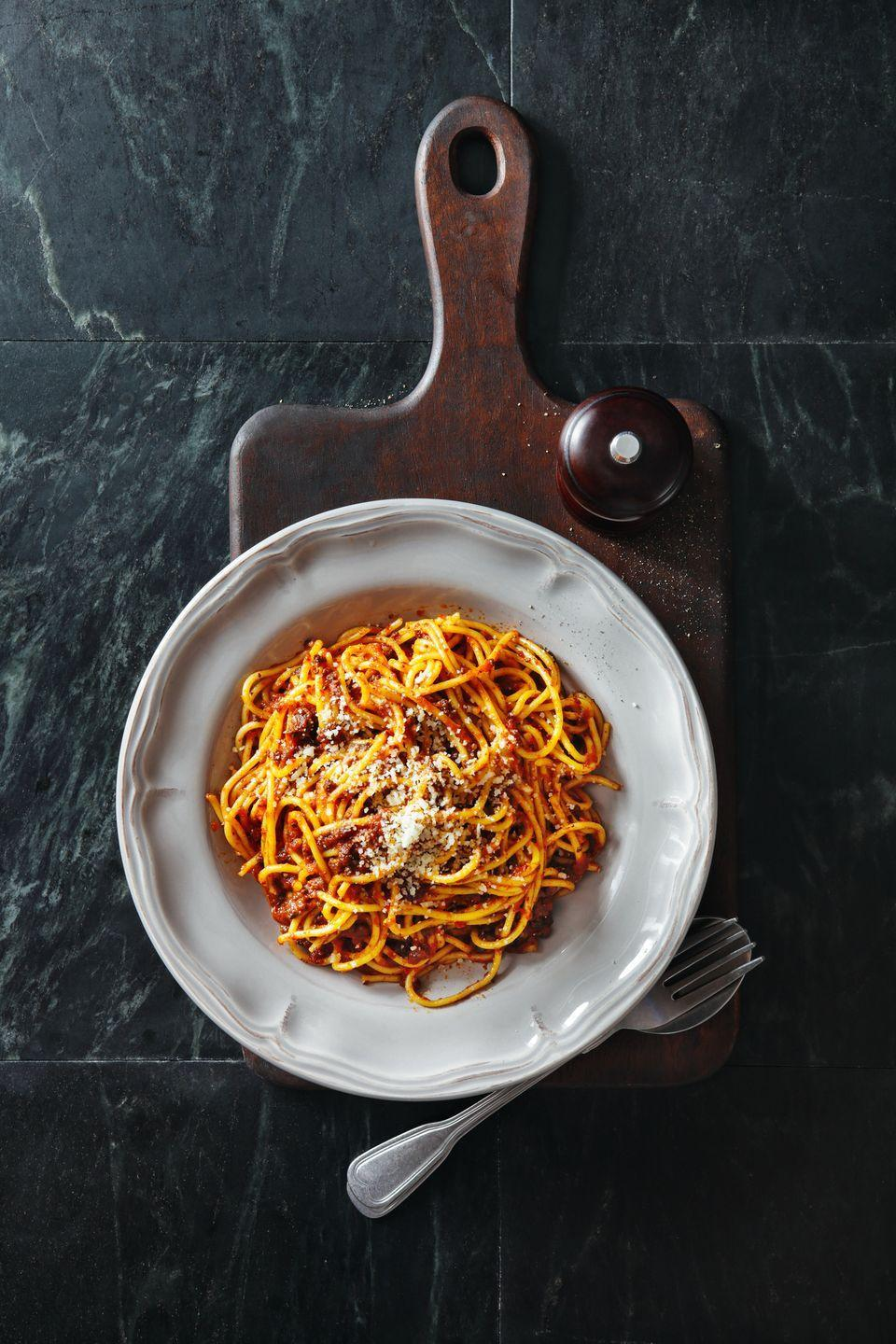 """<p><strong>Recipe: <a href=""""https://www.goodhousekeeping.com/uk/food/recipes/a536276/spaghetti-bolognese/"""" rel=""""nofollow noopener"""" target=""""_blank"""" data-ylk=""""slk:Spaghetti Bolognese"""" class=""""link rapid-noclick-resp"""">Spaghetti Bolognese</a></strong></p>"""