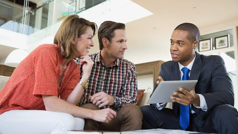 Couple talking to financial adviser