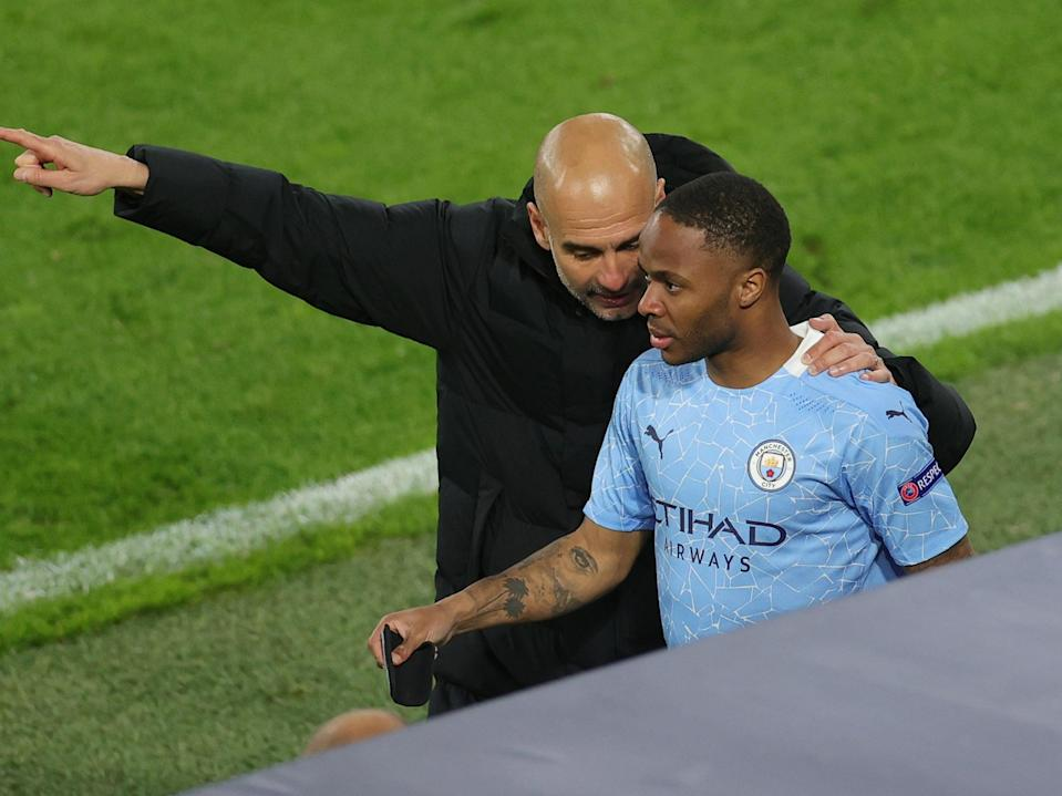Manchester City winger Raheem Sterling with Pep Guardiola (Friedemann Vogel - Pool/Getty Images)