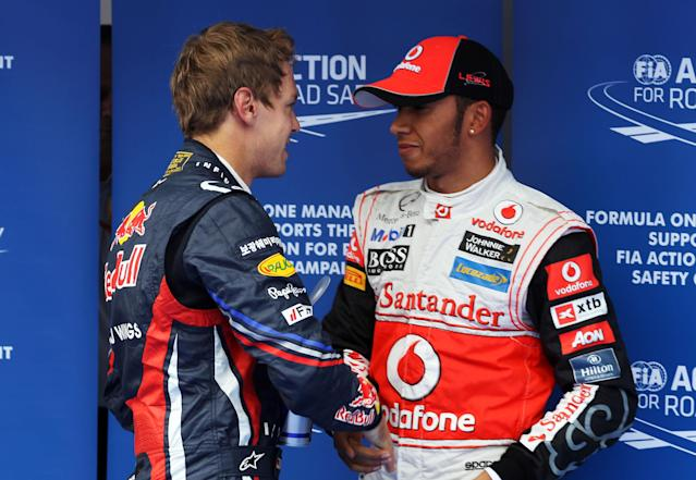 YEONGAM-GUN, SOUTH KOREA - OCTOBER 15: Pole sitter Lewis Hamilton (R) of Great Britain and McLaren is congratulated by second placed Sebastian Vettel (L) of Germany and Red Bull Racing following qualifying for the Korean Formula One Grand Prix at the Korea International Circuit on October 15, 2011 in Yeongam-gun, South Korea. (Photo by Clive Rose/Getty Images)