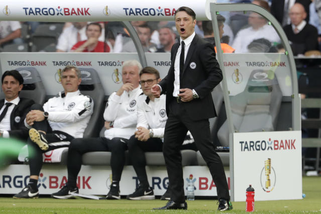 Frankfurt coach Niko Kovac watches his team during the German soccer cup final match between FC Bayern Munich and Eintracht Frankfurt in Berlin, Germany, Saturday, May 19, 2018. (AP Photo/Michael Sohn)