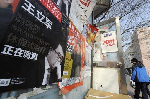 This file photo shows a poster of a Chinese magazine showing former Chongqing's police chief Wang Lijun, in Beijing, in February. Wang will go on trial in southwest China next week, a court said, the latest stage in a scandal that has rocked the Communist party ahead of a 10-yearly power handover