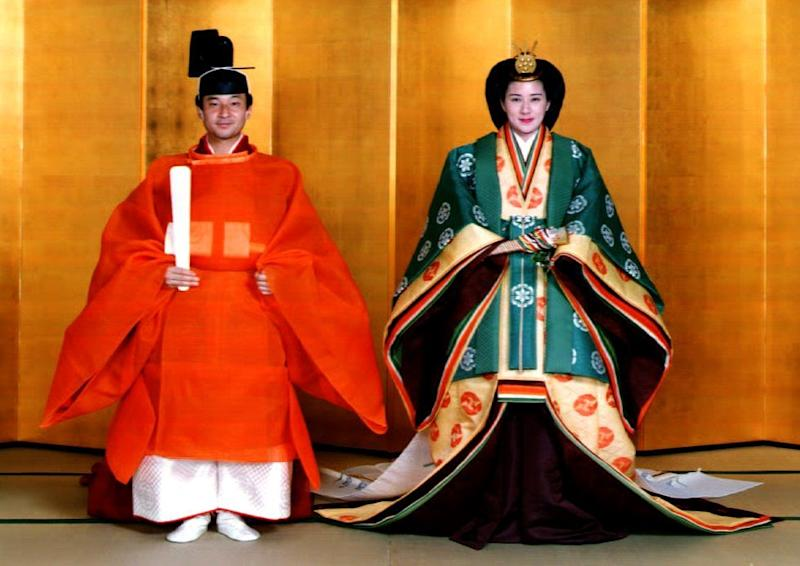 Japanese Crown Prince Naruhito and his bride, Masako Owada, in full traditional Japanese Imperial wedding costumes at the Imperial Palace in 1993 (AFP Photo/Handout)