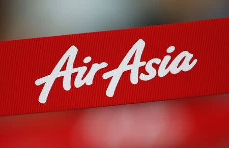 An AirAsia sign is pictured at its check-in counter at Changi Airport in Singapore