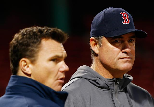 BOSTON, MA - OCTOBER 29: Manager John Farrell #53 of the Boston Red Sox and Executive Vice President and General Manager of the Boston Red Sox, Ben Cherington, watch as the team warms up during the team workout Fenway Park on October 29, 2013 in Boston, Massachusetts. (Photo by Jared Wickerham/Getty Images)