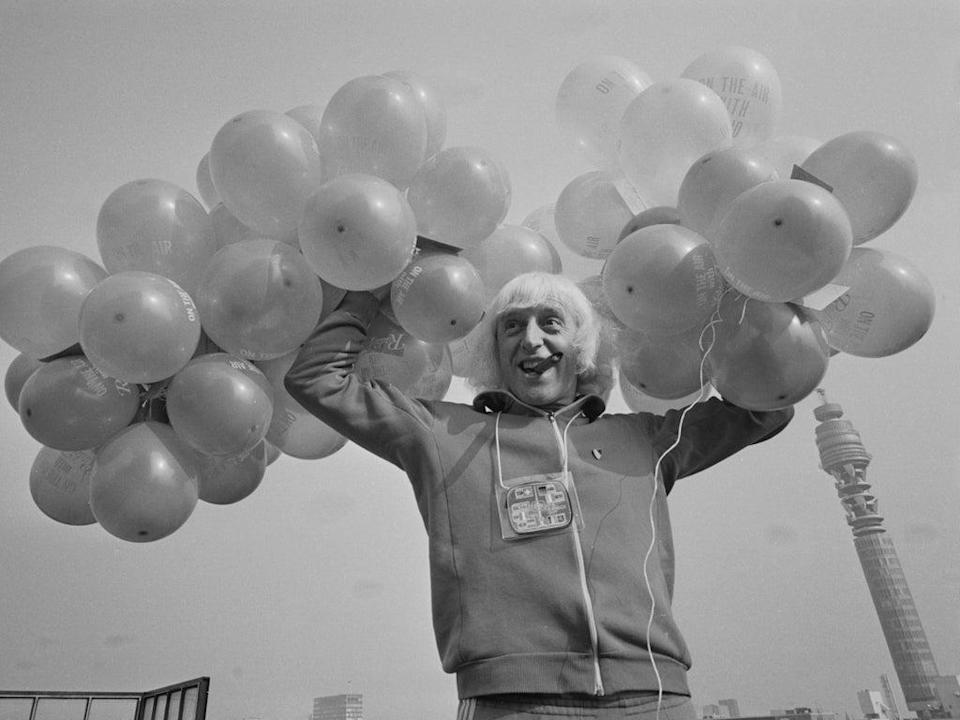 Jimmy Savile on the roof of Broadcasting House in London to celebrate the BBC Radio station's fifth anniversary, 30 September 1972 (Getty Images)